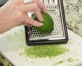 Grating a lime. — Stock Photo
