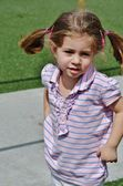 A cute little girl in pigtails. — Stock Photo