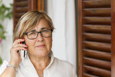 Senior woman using mobile phone — Stock Photo