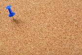 Cork board with blue pin — Stock Photo