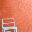 White chair and orange wall — Stock Photo #31659291