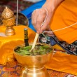 Monk do holy water — Stock Photo