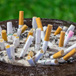 Cigarettes butt in ashtray — Stock Photo