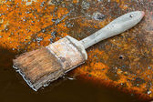 Dirty oil and brush — Stock Photo