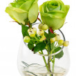 Green rose and berry in glass vase — Stock Photo