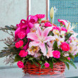 Stock Photo: Bouquet of flower in wicker basket