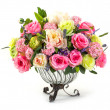 Bouquet of roses in glass vase — Stock Photo