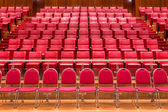 Close up red theatre chair in meeting room — Stock Photo