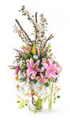 Bouquet of orchid and lily in glass vase — Stock Photo