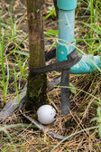 Golf ball near the tab water pipe — Stock Photo