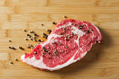 Aged beef ribeye with pepper — Stock Photo
