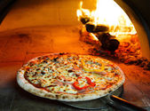 Firewood oven pizza — Stock Photo