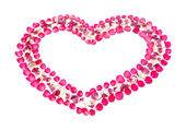 Heart shape symbol from rose petal — Stock Photo