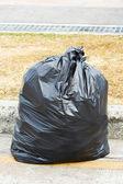 Black garbage bag — Stock Photo