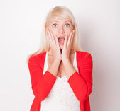 The beautiful fresh blonde the girl is surprised and very glad — Stock Photo