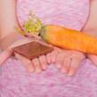 Chocolate or a carrot — Stock Photo