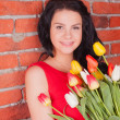 Beautiful girl with flowers tulips — Stock Photo