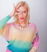 Blonde girl in a bright jacket looks in a shot — Stock Photo