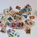 Постер, плакат: Postage stamps in bulk