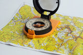 Compass and a map. — Stock Photo