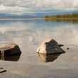 Stock Photo: Lake Lama, stones in water.