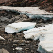 The ice-field in the tideway of the mountain river. — Stock Photo