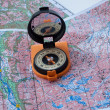 Stock Photo: Compass and map.