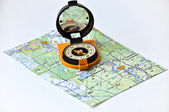 Compass on the map. — Stock Photo