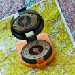 Stock Photo: Map and compass.