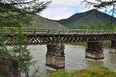 Bridge over the mountain river. — Stock Photo