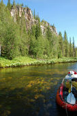 Canoe on the river in the virgin forests of Komi. — Stock Photo