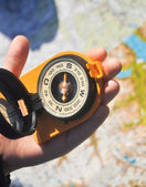 Compass under the sun on the palm — Stock Photo