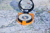 Compass cast a shadow on the map — Stock Photo