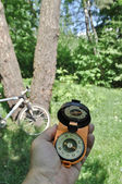 Journey by bike with a compass. — 图库照片
