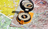 Compass lies on a topographic map.  — ストック写真