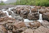 Waterfall in the rocks — Stock Photo