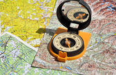 Compass lies on a topographic map.  — Stock Photo