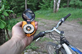 Journey by bike with a compass. — Stock Photo