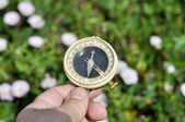 The compass in his hand. — Stock Photo