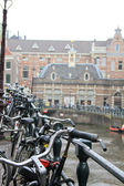 Bicycles on the background of Amsterdam canals. — Stockfoto