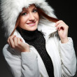 A photo of sexual beautiful girl is in fashion style in a jacket with a fur hood — Stock Photo