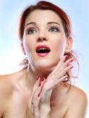 Beautiful redheaded girl, emotions, cosmetics — Stock Photo