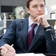 Portrait deliberating businessman with documents — Stock Photo