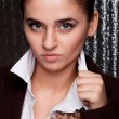 Portrait of a girl holding a shirt collar with a stern look — Stock Photo #30018269