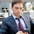 Portrait of a businessman looking at the phone — Stock Photo #30145341