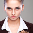 Portrait of a girl with a stern look, looking directly — Stock Photo