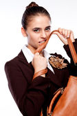 Portrait of a girl biting her bag — Stok fotoğraf