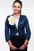 Portrait of a smiling girl in a suit with a folder — Stock Photo