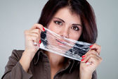 Portrait of a girl covering her mouth with cling film — Stock Photo