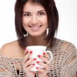 Portrait of a smiling girl holding a cup of tea — Stock Photo